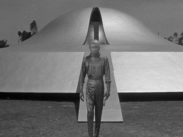 scifi, movie, 1950's, man infront of a spaceship